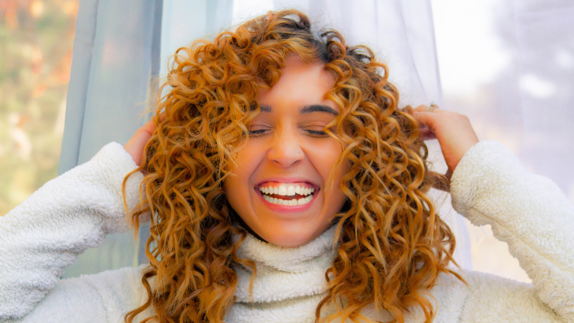 Curly Hair? Here's How to Take Care of It All Winter Long